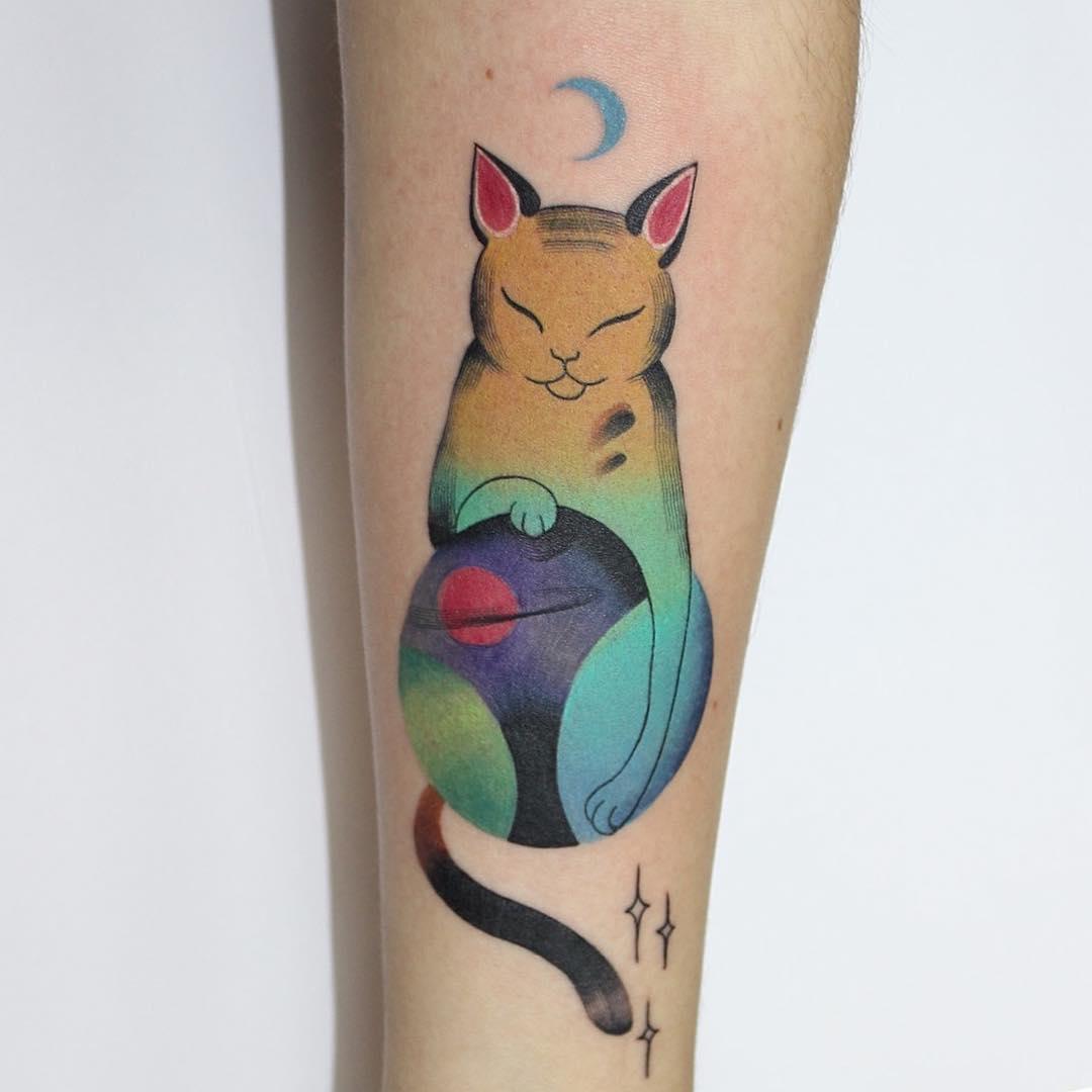 Cute cat holding a globe