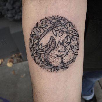 Cute circular tattoo of a squirrel