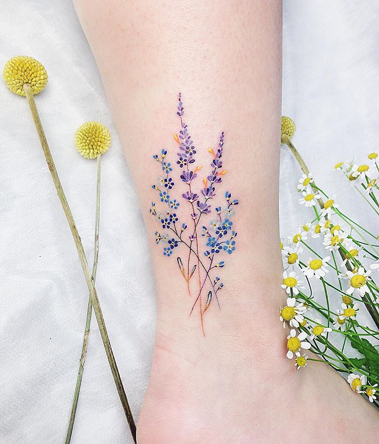 Delicate blue and violet wildflowers tattoo