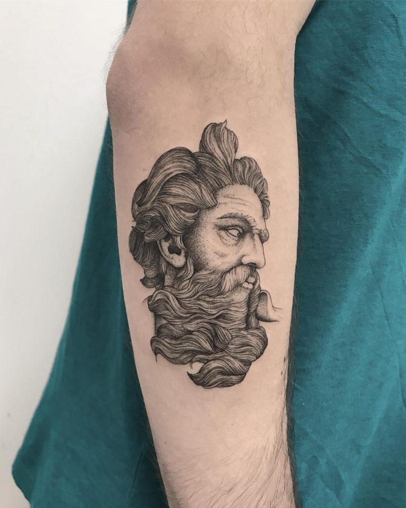 Detailed man's head tattoo
