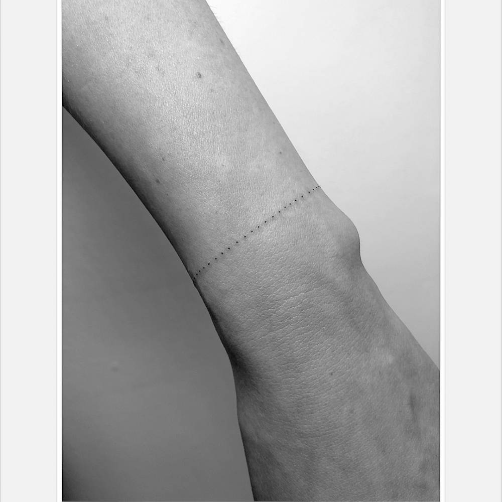 Dotted bracelet tattoo