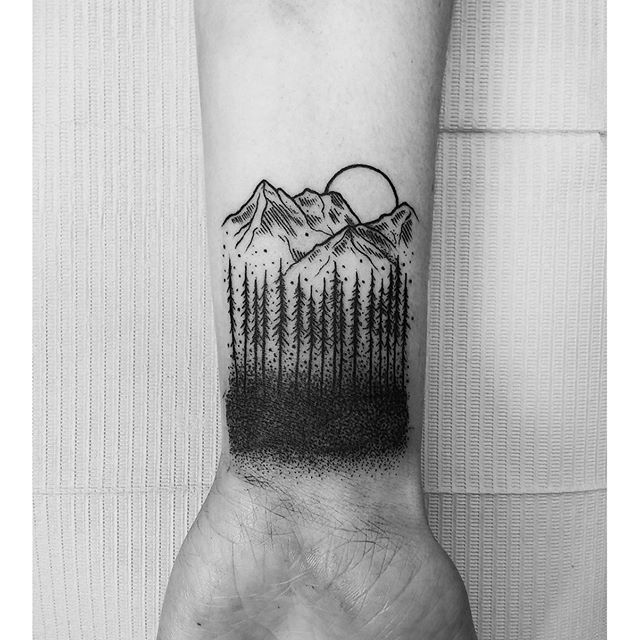 Dotwork trees mountains and sun tattoo