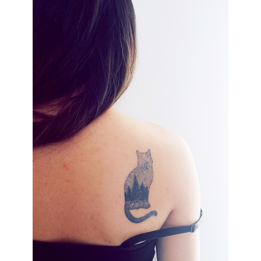 Double exposure kitty and landscape tattoo