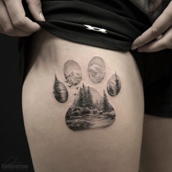 Double exposure paw and landscape tattoo
