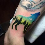 Double exposure wolf and landscape tattoo