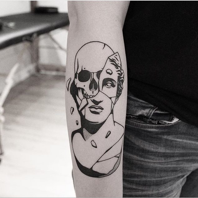 Eroding antique bust and skull tattoo