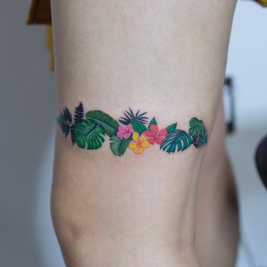 Exotic plants tattoo around the leg