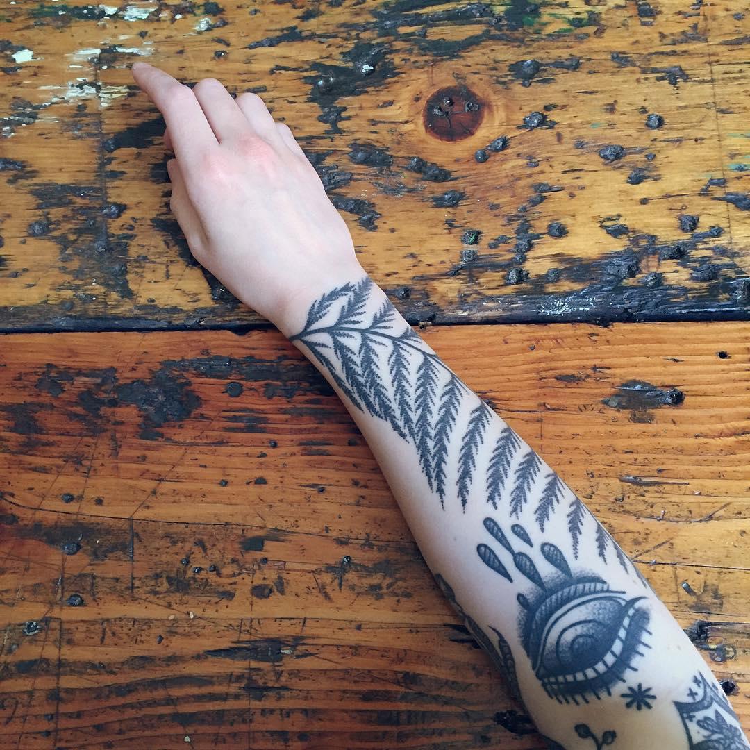 Fern leaf and crying eye tattoo