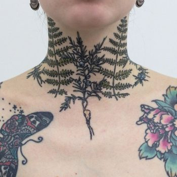 Fern leaves tattoo on the neck
