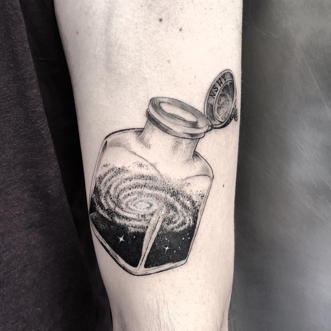 Galaxy in an ink bottle tattoo