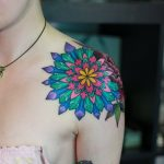 Geen and red mandala tattoo