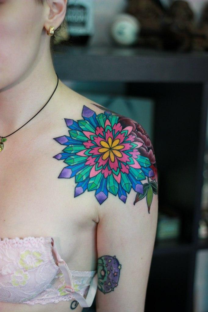 Geen and red mandala tattoo