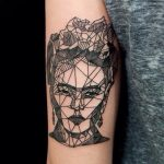Geometric frida kahlo face tattoo