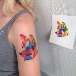 Geometric colorful wolf head tattoo