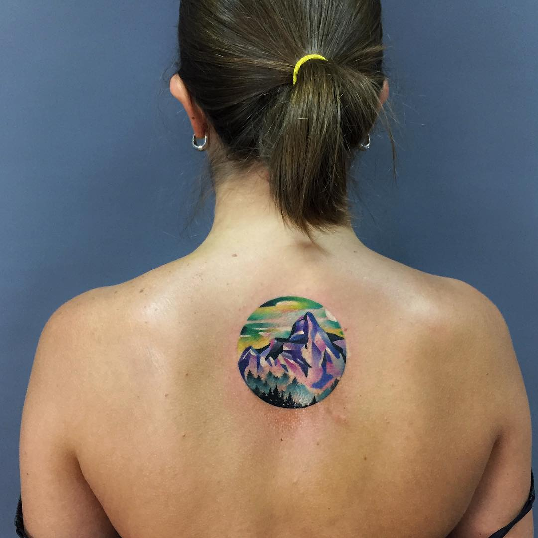 Geometric style mountainous landscape tattoo