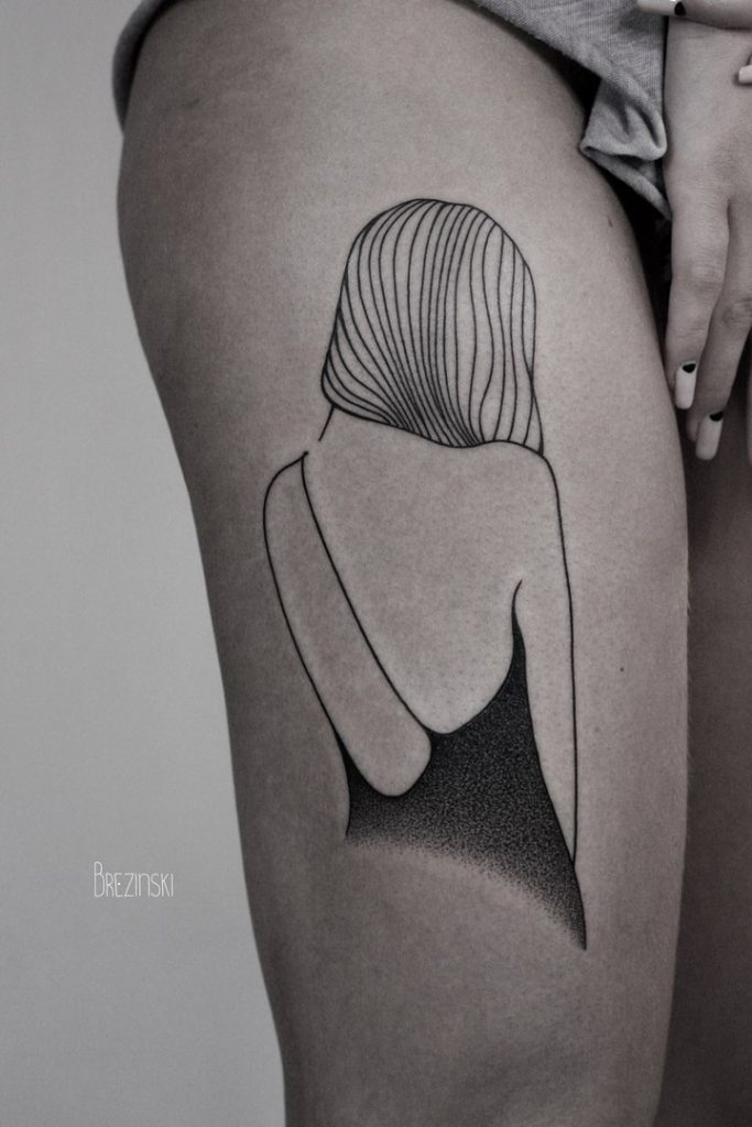 Girl tattoo on the thigh