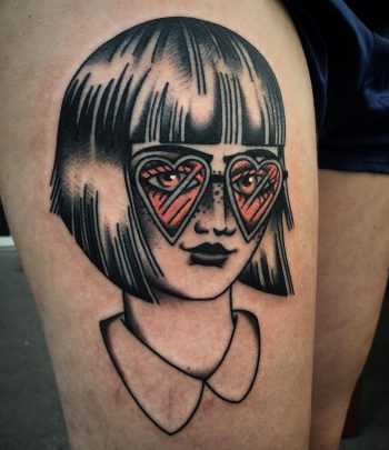 Girl with heart shaped glasses tattoo