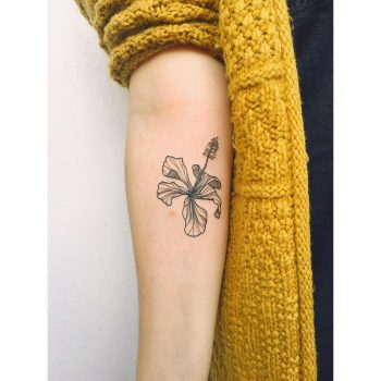 Gorgeous black and grey flower tattoo on the inner forearm