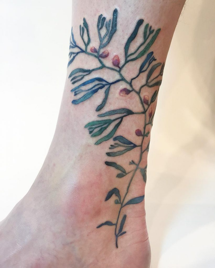 Green and red plant tattoo