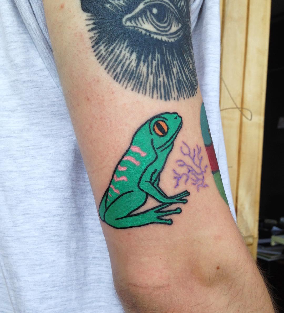 Green frog tattoo