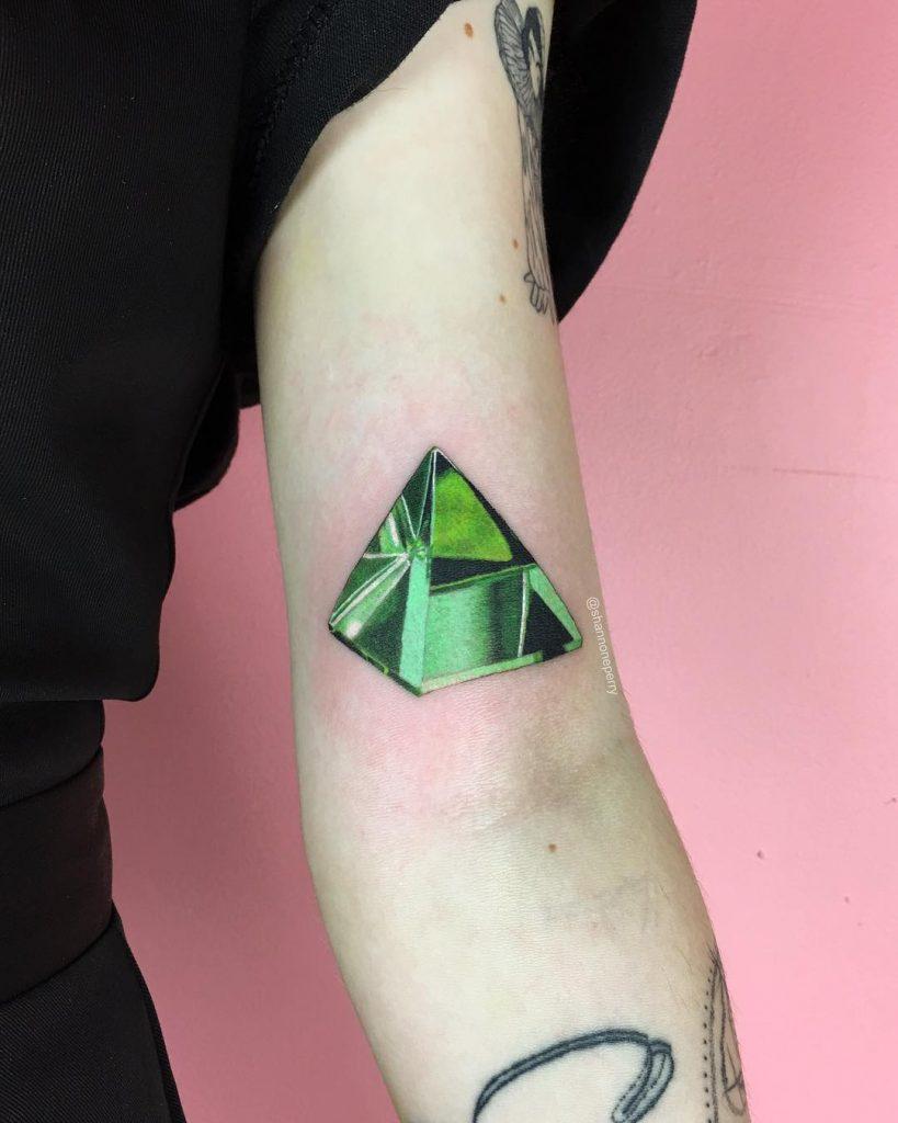 Green triangular diamond tattoo
