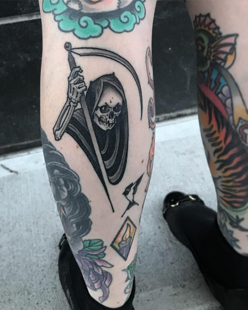 Grim reaper tattoo on the left calf