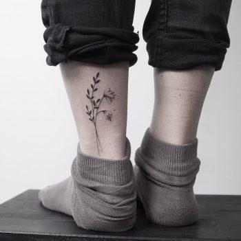 Hand poked minimalist flower tattoo