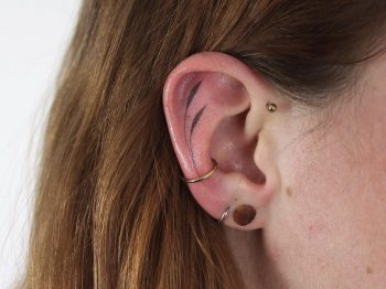 Hand poked tattoo on the ear