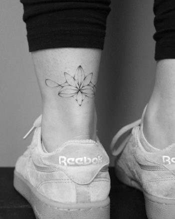 Handpoked lotus flower tattoo