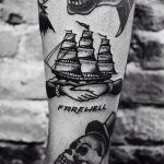 Handshake and ship tattoo
