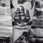 Handshake and ship tattoo