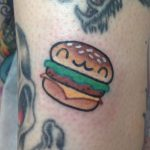 Happy mini burger tattoo
