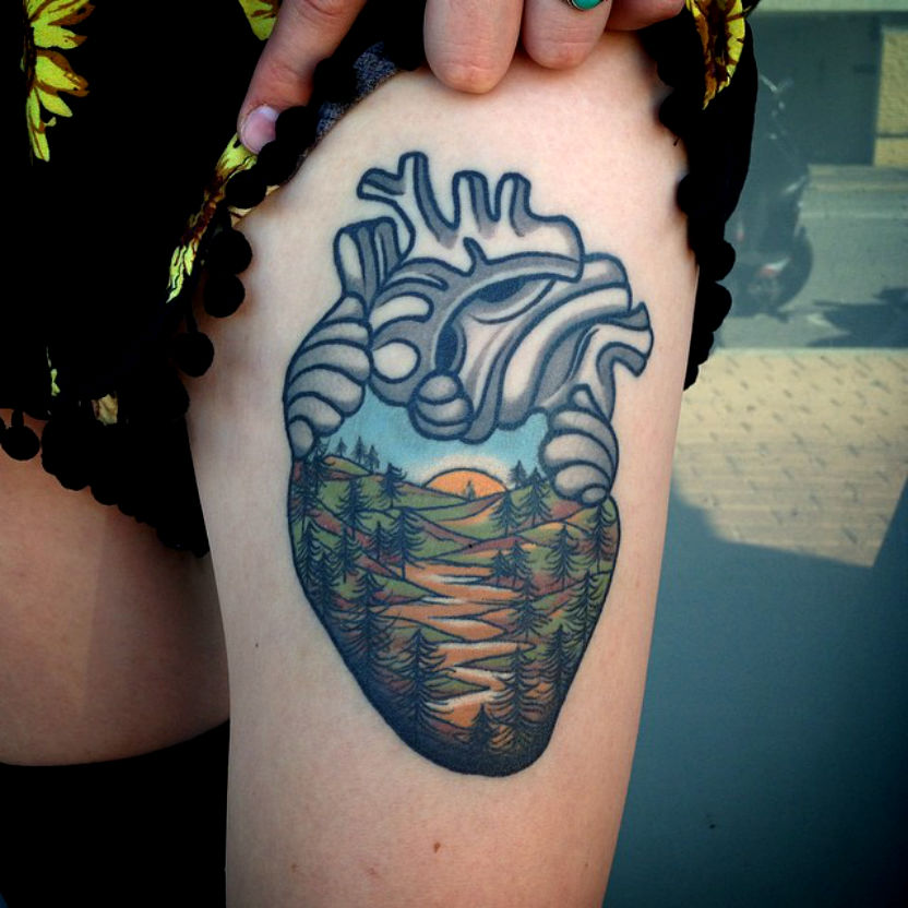 Heart and a river landscape tattoo