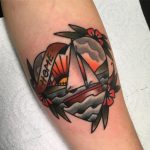 Heart shaped tattoo of a boat