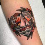 Heart shaped tattoo of a boat