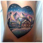 Heart shaped winter landscape tattoo