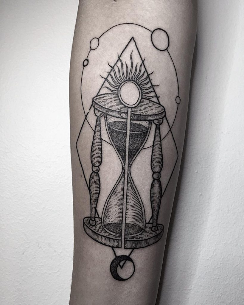 Hourglass and solar system tattoo
