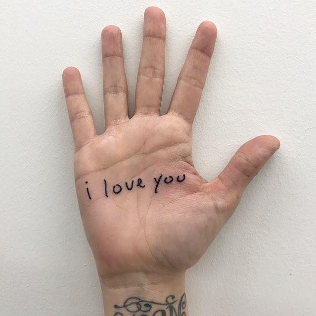 I love you tattoo on the palm