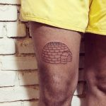 Igloo tattoo on the thigh