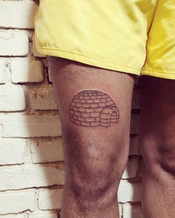 Igloo tattoo on the thigh