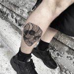 Linear black skull tattoo
