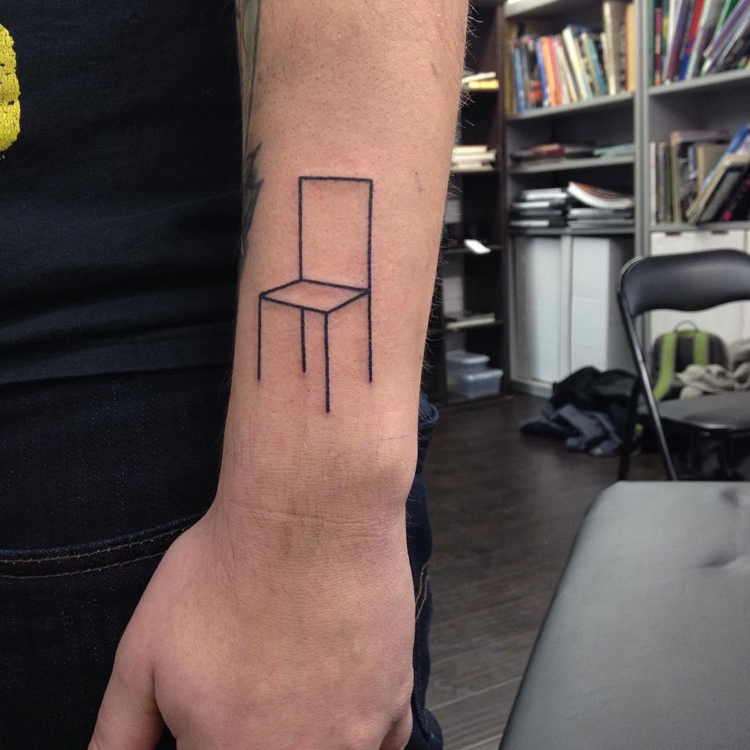 Linear minimalist chair tattoo