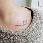 Little kite tattoo on the clavicle