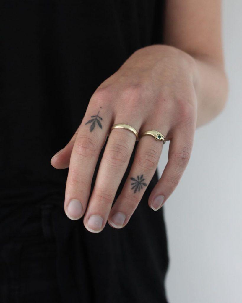 Little ornament tattoos on fingers