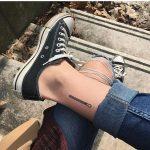 Match stick tattoo