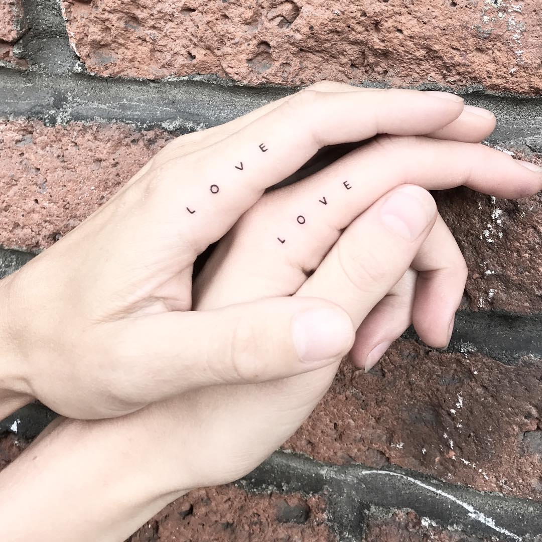 Matching love tattoos