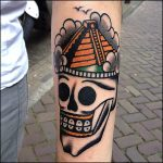 Mesoamerican pyramid and skull tattoo