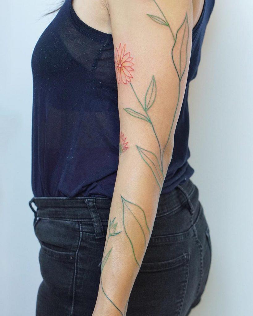 Minimal calendula flowers tattoo