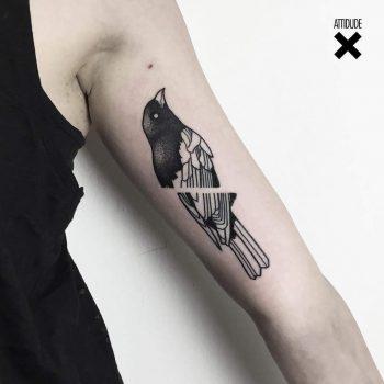 Minimalist crow tattoo