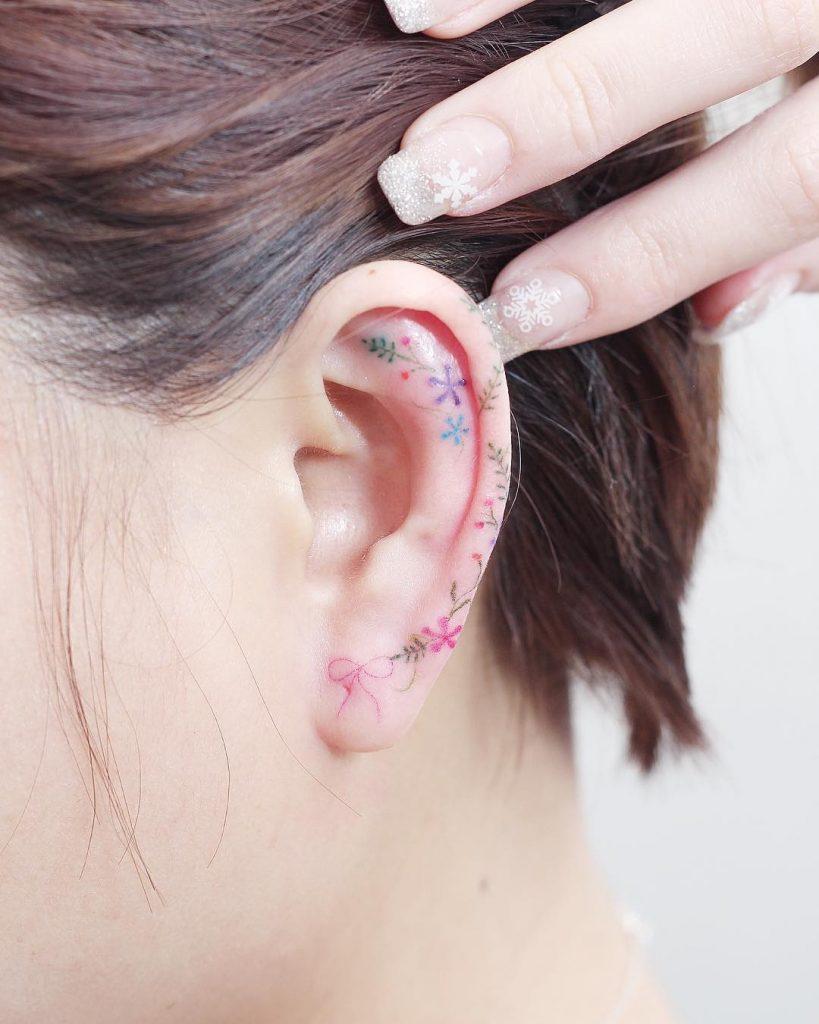 Minimalist flower tattoos on the left ear
